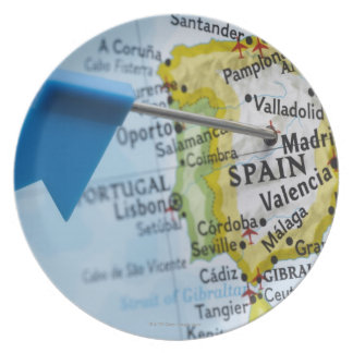 Map pin placed in Madrid, Spain on map, close-up Plate