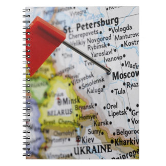 Map pin placed in Moscow, Russia on map, Notebook