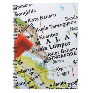 Map pin placed in Singapore on map, close-up Spiral Note Books