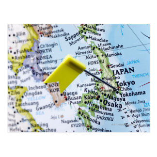 Map pin placed in Tokyo, Japan on map, close-up Postcard