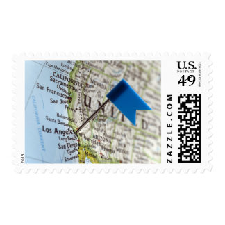 Map pin placed on Los Angeles, California on Postage Stamp