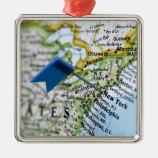 Map pin placed on New York City on map, close-up Silver-Colored Square Decoration
