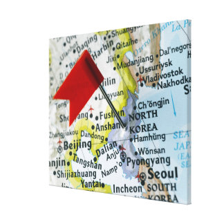 Map pin placed on North Korea on map, close-up Canvas Print