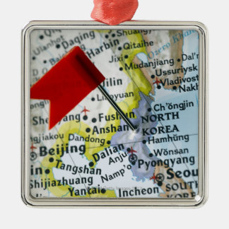 Map pin placed on North Korea on map, close-up Christmas Ornament
