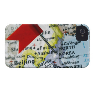 Map pin placed on North Korea on map, close-up iPhone 4 Cover