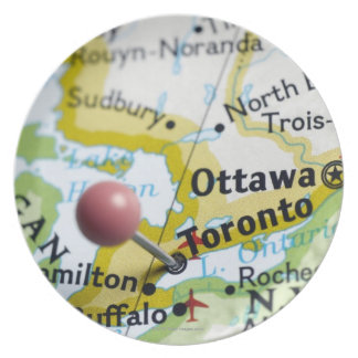Map pin placed on Toronto, Canada on map, Plate