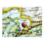 Map pin placed on Toronto, Canada on map, Postcards