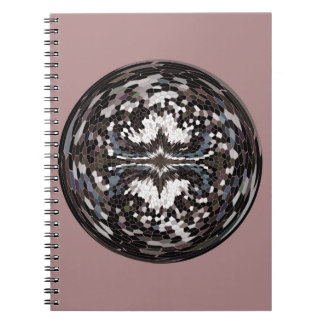 Marble globe on pink notebooks