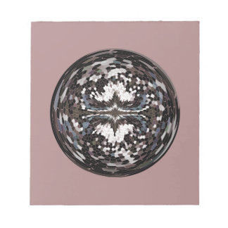 Marble globe on pink notepad