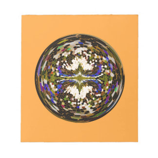 Marble globe on yellow notepad