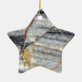 Marble surface with fractures. ceramic star decoration