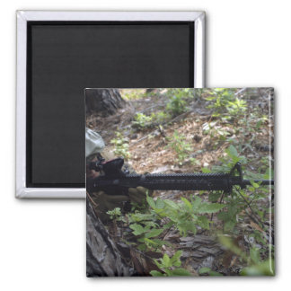 Marine uses a tree for cover and concealment square magnet