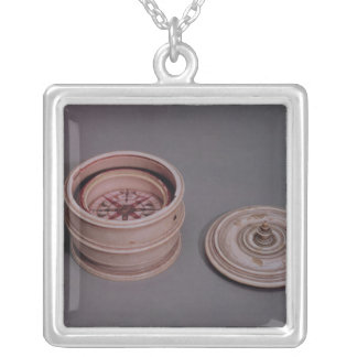Mariner's compass in an ivory case silver plated necklace