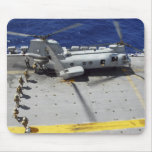 Marines board a CH-46E Sea Knight helicopter Mouse Pad