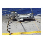 Marines board a CH-46E Sea Knight helicopter Photo Print
