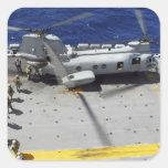 Marines board a CH-46E Sea Knight helicopter Square Sticker
