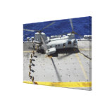 Marines board a CH-46E Sea Knight helicopter Stretched Canvas Print