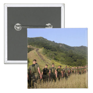 Marines hike their way to a memorial site 15 cm square badge