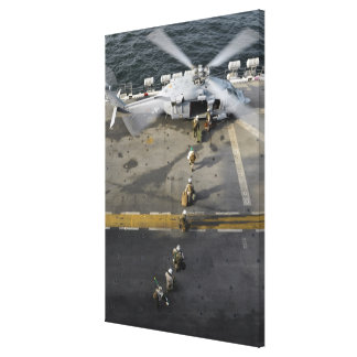 Marines prepare to board an MH-60S Canvas Print