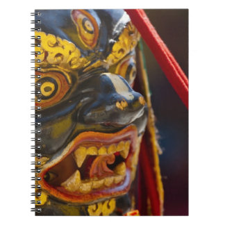 Mask dance performance at Tshechu Festival Spiral Notebook