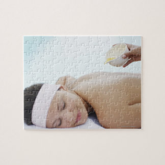 Massage oil being poured on womans back jigsaw puzzle