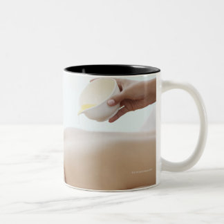 Massage oil being poured on womans back Two-Tone coffee mug