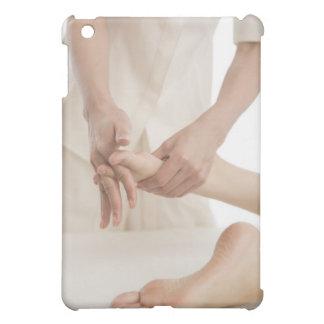 Massage therapist applying foot massage 2 cover for the iPad mini