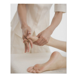 Massage therapist applying foot massage 2 poster