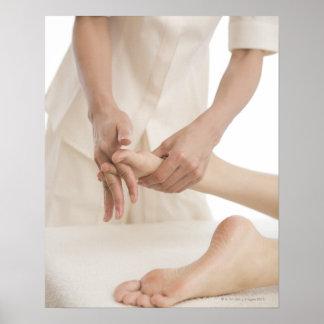 Massage therapist applying foot massage 2 poster