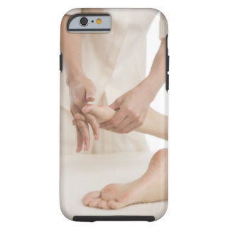 Massage therapist applying foot massage 2 tough iPhone 6 case