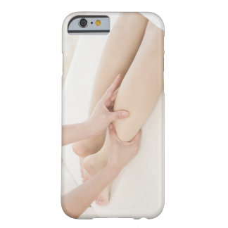 Massage therapist applying foot massage barely there iPhone 6 case