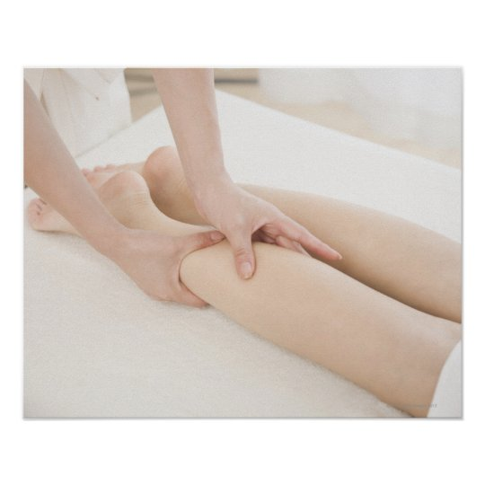Massage therapist applying foot massage poster