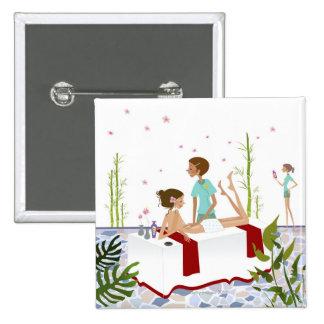 Massage therapist massaging a woman lying on a 15 cm square badge