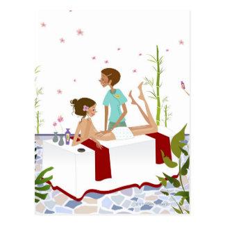 Massage therapist massaging a woman lying on a postcard