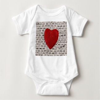 Material background with heart baby bodysuit