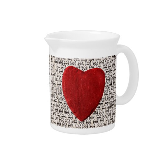 Material background with heart drink pitcher