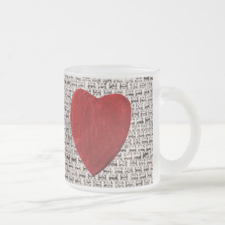 Material background with heart frosted glass coffee mug