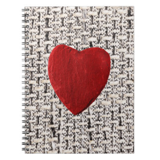 Material background with heart spiral note books