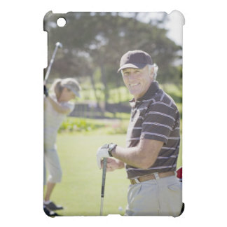 Mature couple playing golf cover for the iPad mini