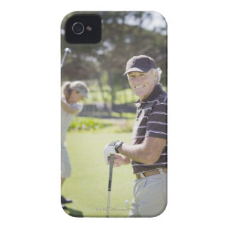Mature couple playing golf iPhone 4 cases