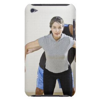 Mature man assisting woman, exercising using iPod touch Case-Mate case
