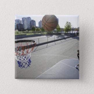 mature man shooting basketball 15 cm square badge