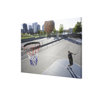 mature man shooting basketball canvas print