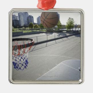 mature man shooting basketball christmas ornament