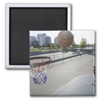 mature man shooting basketball magnet