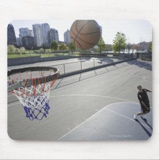 mature man shooting basketball mouse mat