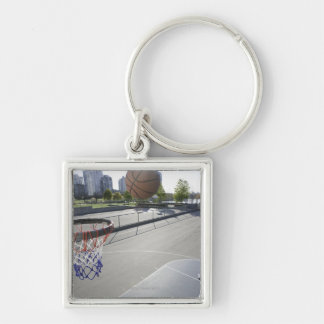 mature man shooting basketball Silver-Colored square key ring