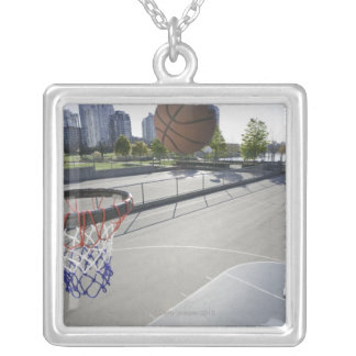 mature man shooting basketball silver plated necklace