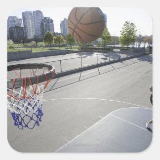 mature man shooting basketball square sticker