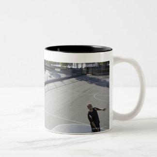 mature man shooting basketball Two-Tone coffee mug